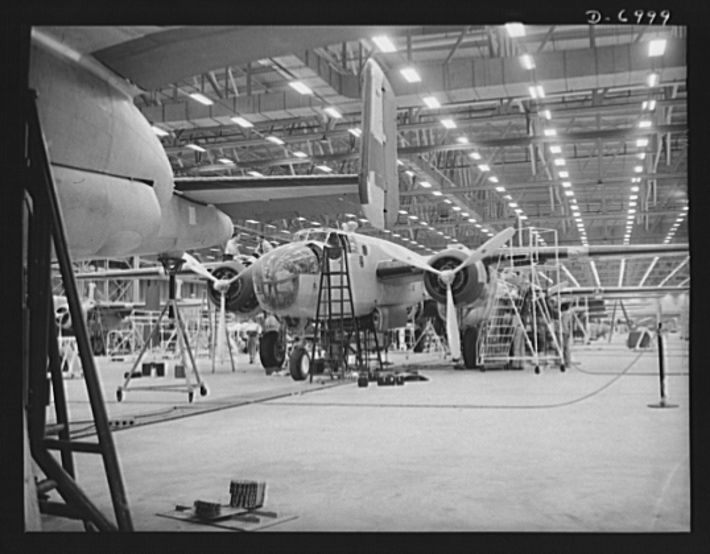 Production. B-25 bombers. They'll soon be ready to hurl their might at the Axis. New B-25 medium bombers nearing the end of a Western aircraft assembly line. General Doolittle calls it the best military plane in existence. Fairfax bomber plant, Kansas City