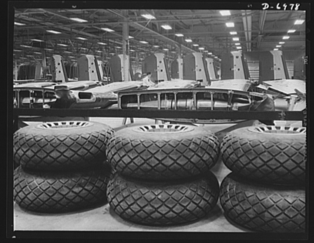 Production. B-25 bombers. Tires, wing sections and empennage assemblies for B-25 bombers, ready for the assembly lines of a Western aircraft plant. General Doolittle has called the ship the best military plane in existence. With plenty of speed, a 1700- mile cruising range and a ceiling of 25,000 feet, it has performed brilliantly as a medium bomber and as an escort plane. Fairfax bomber plant, Kansas City