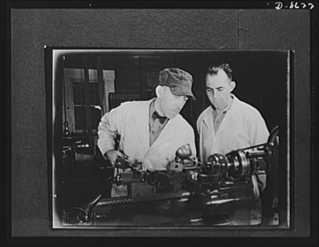 Production. Blood transfusion bottles. In a small plant operating under subcontract, O. Trumbull Scalbom and S.B. Nicholson of Glenview, Illinois, play a vital part in American production. The two men operate a Harding-Bench turret lathe which drills and reams holes in valve stems for blood transfusion bottles prepared by the prime contractor, Baxter Laboratories in Glenview, Illinois