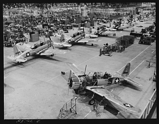 "Production. BT-13A (""Valiant"") basic trainers. Final assembly of ""Valiant"" basic trainers at Vultee's Downey, California plant. At the Downey plant is made the BT-13A (""Valiant"") basic trainer--a fast, sturdy ship powered by a Pratt and Whitney Wasp engine"