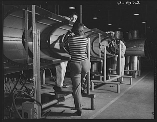 "Production. BT-13A (""Valiant"") basic trainers. Fuselage sections for ""Valiant"" basic trainers at Vultee's Downey, California plant. At the Downey plant is made the BT-13A (""Valiant"") basic trainer--a fast, sturdy ship powered by a Pratt and Whitney Wasp engine"