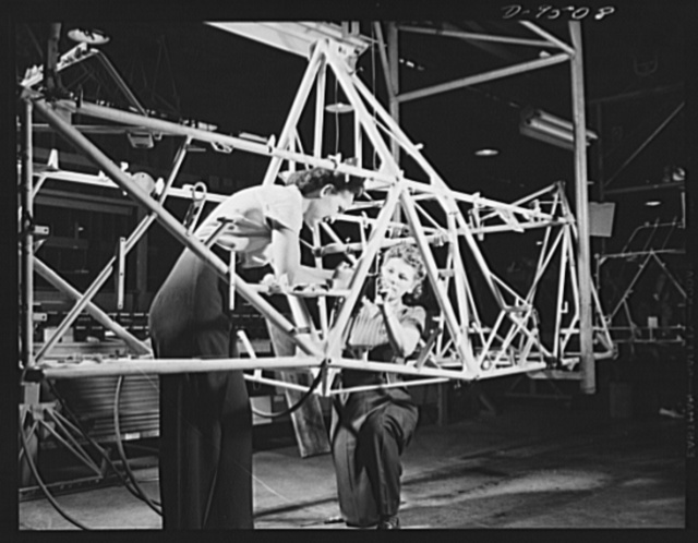 "Production. BT-13A (""Valiant"") basic trainers. Girls on the final assembly line at Vultee's Downey, California plant working on the fuselage of a ""Valiant"" basic trainer. At the Downey plant is made the BT-13A (""Valiant"") basic trainer--a fast, sturdy ship powered by a Pratt and Whitney Wasp engine"