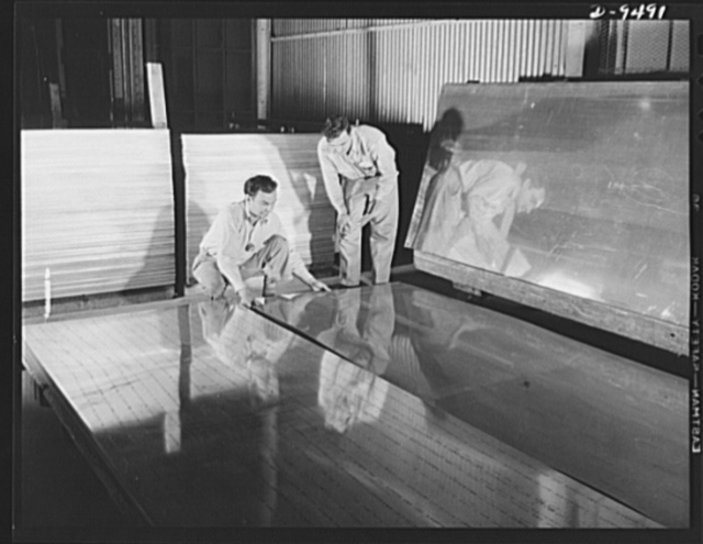 "Production. BT-13A (""Valiant"") basic trainers. Sheet aluminum for warplane construction being sorted at Vultee's Downey, California plant. At the Downey plant is made the BT-13A (""Valiant"") basic trainer--a fast, sturdy ship powered by a Pratt and Whitney engine"