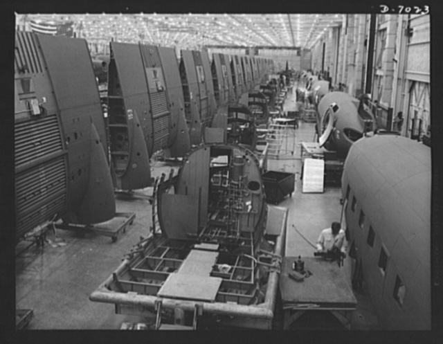 Production. C-47 transport plane. Sections of C-47 transport planes move down the assembly lines of the Long Beach, California plant of Douglas Aircraft Company toward the final assembly line, where all parts are put together. The versatile C-47 performs many important tasks for the Army. It ferries men and cargo across oceans and mountains, tow gliders and brings paratroopers and their equipment to scenes of action (Douglas Aircraft Company)