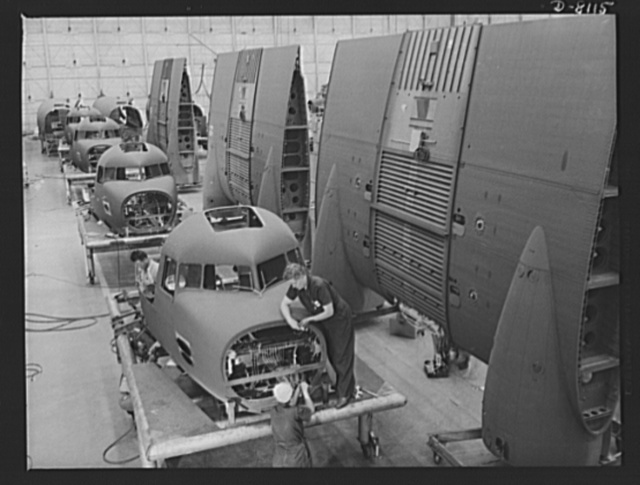Production. C-47 transport planes. Noses and center wings for Douglas C-47 transport planes move toward the assembly line at the Long Beach, California, plant of Douglas Aircraft Company, where they will be joined to their assigned fuselages. The versatile C-47 performs many important tasks for the Army. It ferries men and cargo across the oceans and mountains, tows gliders and brings paratroopers and their equipment to scenes of action