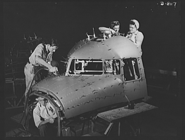 Production. C-47 transport planes. Teams of men and women work efficiently to prepare a C-47 transport plane for riveting operations at the Long Beach, California, plant of Douglas Aircraft Company. The versatile C-47 performs many important tasks for the Army. It ferries men and cargo across the oceans and mountains, tows gliders and brings paratroopers and their equipment to scenes of action