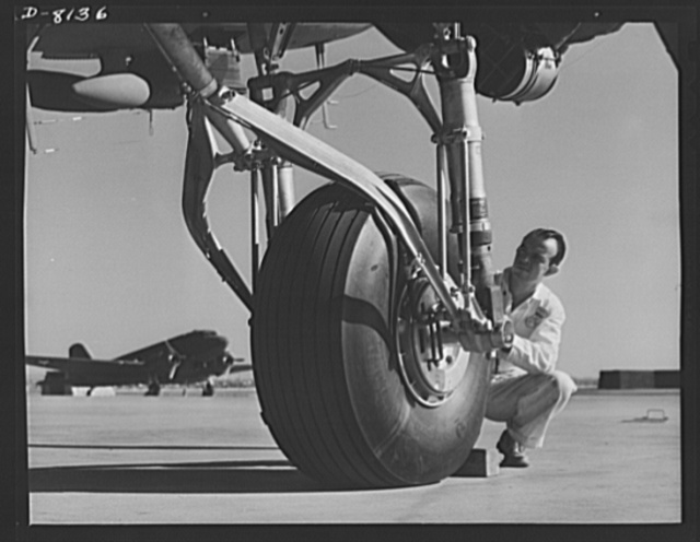 Production. C-47 transport planes. The rugged landing gear of a C-47 transport plane must stand terrific pounding over rough ground and emergency landing fields. Picture taken on the Long Beach, California, flight ramp of the Douglas Aircraft Company. The versatile C-47 performs many important tasks for the Army. It ferries men and cargo across oceans and mountains, tows gliders and brings paratroopers and their equipment to scenes of action