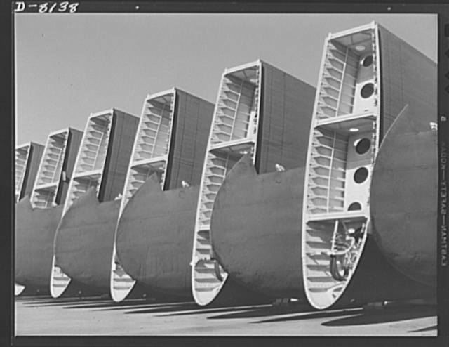 Production. C-47 transport planes. Wings for C-47 transport planes ready for the assembly line at Long Beach, California, Douglas Aircraft Company. The versatile C-47 performs many important tasks for the Army. It ferries men and cargo across oceans and mountains, tows gliders and brings paratroopers and their equipment to scenes of action