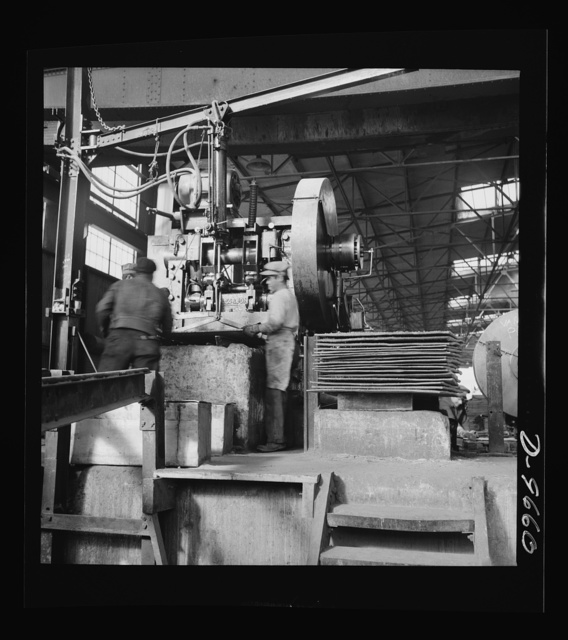 Production. Copper (refining). Shearing sheets of copper produced by electrolysis at a large refining operation. Large amounts of copper are produced for the war effort at the El Paso, Texas plant of Phelps-Dodge Refining Company