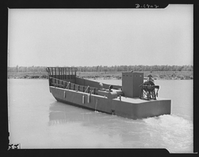 Production. Fifty-foot steel ramp boats. A fifty-foot steel ramp boat, just completed at a Southern boatyard, makes a trial run. Boats of this kind are used in making beach landings of men, tanks, and other equipment on hostile shores. The yard is also making torpedo boats, smaller wooden ramp boats and other Navy craft