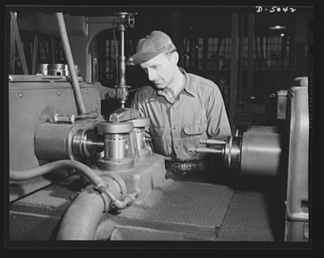 Production. Jeep engines. Cylinders are drilled in jeep engine blocks on the special machinery of a Midwest motor plant. The best of material and workmanship go into the power plants of the tough little army cars. Continental Motors, Michigan