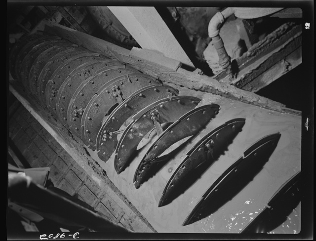 """Production. Lead. An Akins type classifier in a lead concentrator near Creede, Colorado where old mines have been reopened. The classifier sends back to the ball mill all ore not crushed to pass a screen of specified mesh. Creede, for many years a """"ghost town,"""" has resumed the activities that made it an important lead-producing center years ago and is now producing much metal vitally needed for the war effort"""