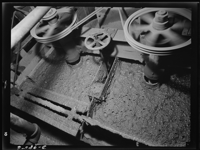 "Production. Lead. Flotation machines in a lead concentrator near Creede, Colorade where old lead mines have been reopened. Creede, for many years a ""ghost town,"" has resumed the activities that made it an important lead-producing center years ago, and is now producing much metal vitally needed for the war effort"