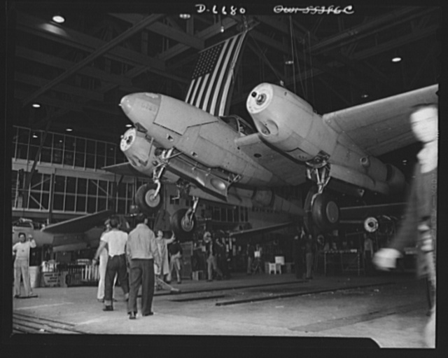 Production. Lockheed P-38 pursuit planes. Another new Lockheed P-38 pursuit ship leaves the main assembly line of a large Western aircraft plant. The station stand has been swept clear and the ship is being lowered away to rest on its own wheels. From here it will be rolled to a test field where propellers will be installed. If trial flights and final inspections prove it satisfactory, the ship will be delivered to the Army