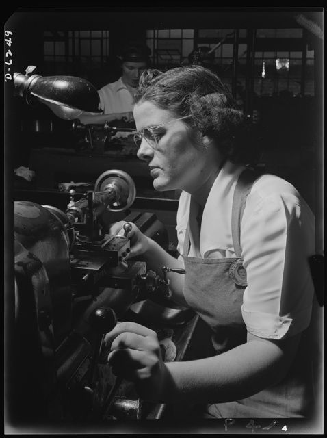 Production. Machine guns of various calibers. Agnes Mahan, bench lathe operator at a large Eastern firearms plant, makes oil drills for .50- caliber machine gun barrels. Many women workers are employed in this plant, producing essential weapons for the armed forces