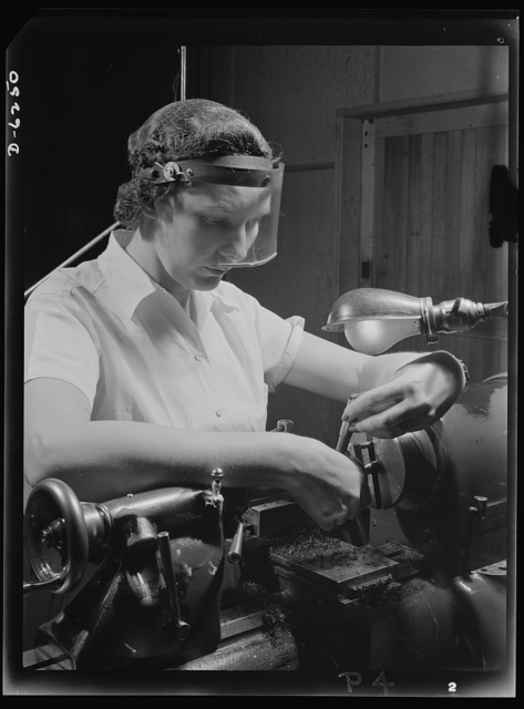 Production. Machine guns of various calibers. Dorothy Taylor, bench lathe operator at a large Eastern firearms plant, makes oil drills for .50- caliber machine gun barrels. Many women workers are employed in this plant, producing essential weapons for the armed forces