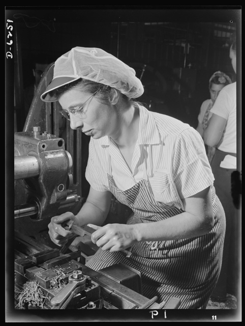 Production. Machine guns of various calibers. Mayna Lentz performs a milling machine operation on the pawl pin of a machine gun that will tell the Axis about the superiority of American weapons. This girl operator in a large Eastern plant is one of many women arsenal workers producing essential weapons for the armed forces