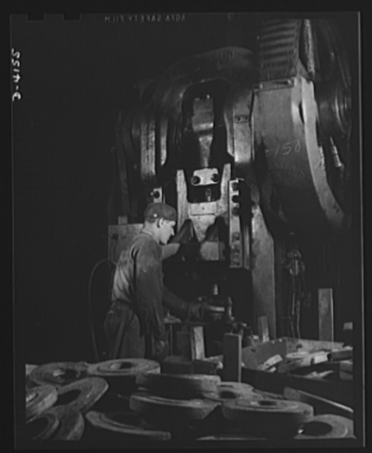 Production. Marine boilers. A big press performs an operation on heavy flanges in a Midwest plant which has converted all its facilities to war production