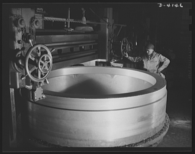 Production. Marine boilers. A turning operation on a large gun mount casting in a big Midwest plant backing the war production drive with all its facilities