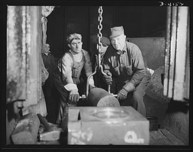 Production. Marine boilers. Driving a die key on a forging hammer in a big Midwest plant processing heavy hydraulic fittings and other necessary equipment for the Army