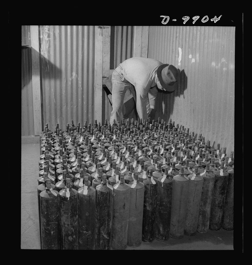 Production. Mercury. Filling flasks of triple-distilled mercury at a New Idria, California extraction plant. Each flask contains seventy-six pounds of mercury. Triple-distilled mercury is produced here by the New Idria Quicksilver Mining Company from cinnabar, an ore containing sulfur and mercury, mined at a number of workings near the plant