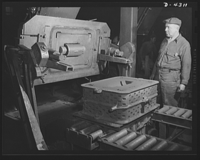 Production. Milling machines and machine castings. Foundrymen make sculptures in sand more exact then many a work of art. Shown here is a rollover machine for small work. The pattern (left) is first placed face up, and the flask (iron cast on conveyor) placed over it. Special sand is tightly rammed into the flask; then this machine inverts the assembly and withdraws the pattern as shown, leaving a perfect mold. Location: a large Midwest machine tool plant