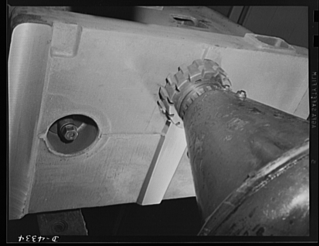 Production. Milling machines and machine castings. If it isn't level, it won't work accurately. Milling the bottom bearing pads of a milling machine column casting. Location: a large Midwest machine tool plant
