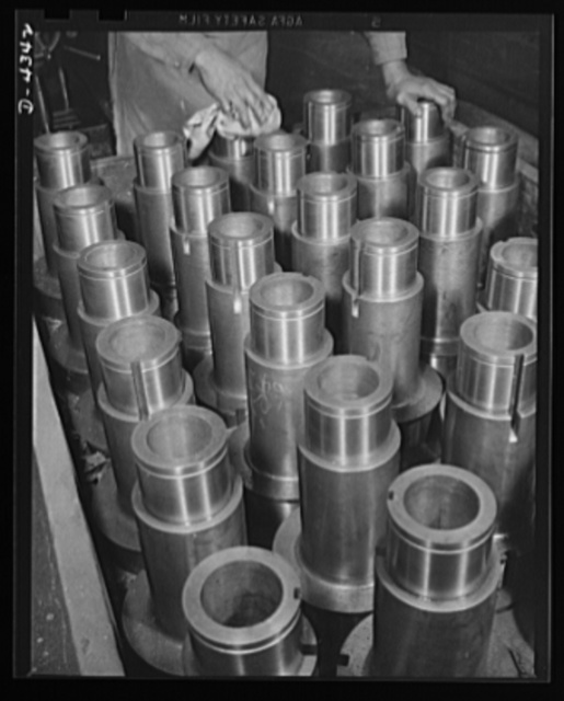 Production. Milling machines and machine castings. Polishing spindle sleeves in a large Midwest plant producing essential machine tools for the war production program