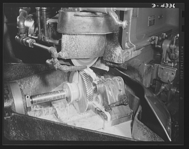 Production. Milling machines and machine castings. Precision gears are essential for machine tools to ensure accurate, smooth, quiet operations and long life. This gear grinder -- itself a machine tool -- is perfecting the working surfaces between the teeth of a milling machine gear. The milky liquid is coolant used to control the temperature at the grinding point so that the delicate physical character of the metal, produced by predetermined and careful heat treating, will not be disturbed. Location: a large Midwest machine tool plant