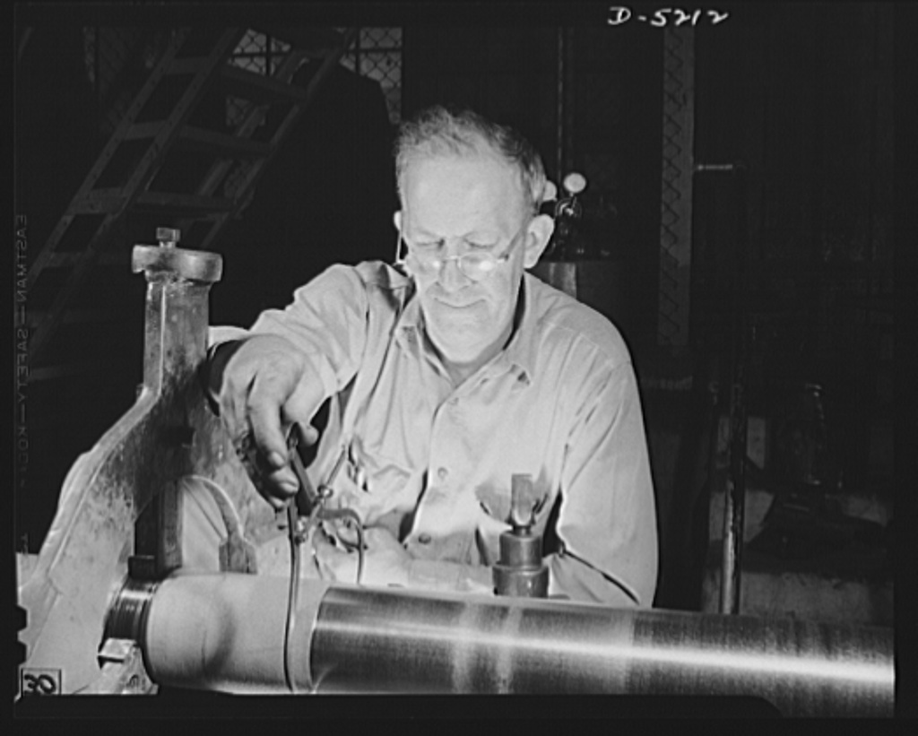 Production. Minesweepers. A veteran of the last world war operates a lathe that turns out tail shafts for minesweepers under construction in an Eastern shipyard. Gibbs Cass Company