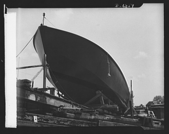 Production. Motor torpedo boats (wooden). A new seventy-eight-foot wooden torpedo boat ready for launching at a Southern shipyard. It was built indoors, of prefabricated parts and sections, and is now being moved to nearby water