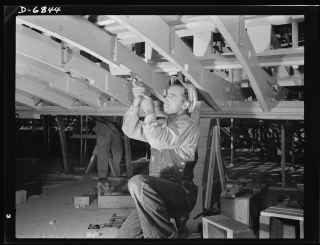 Production. Motor torpedo boats (wooden). Hand trades are important in the building of wooden boats for the Navy. This man working with a chisel on a beam of a motor torpedo boat in a Southern shipyard performs an essential war task. Higgins Industries