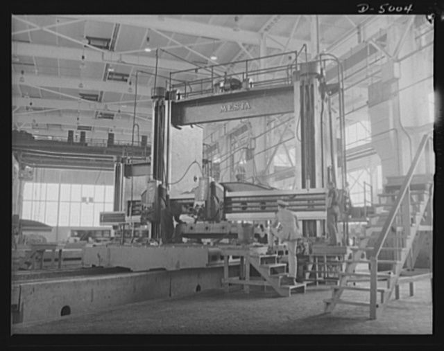 Production. Naval gun mounts. A large casting for a naval gun mount goes through a planing operation in a Midwest plant which is producing gun and torpedo tube mounts in great numbers. Westinghouse, Louisville