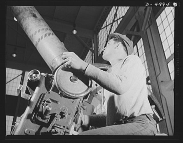 Production. Naval gun mounts. A naval gun mount assembly, one of many produced in a Midwest plant, is carefully inspected before shipment to an undisclosed destination. Westinghouse, Louisville