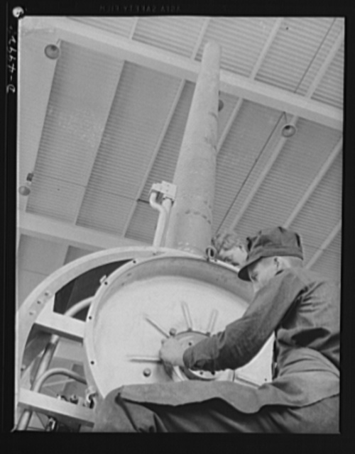 Production. Naval gun mounts. A naval gun mount assembly, one of many produced in a Midwest plant, is carefully inspected before shipment to an undisclosed destination. Westinghouse, Louisville, Kentucky