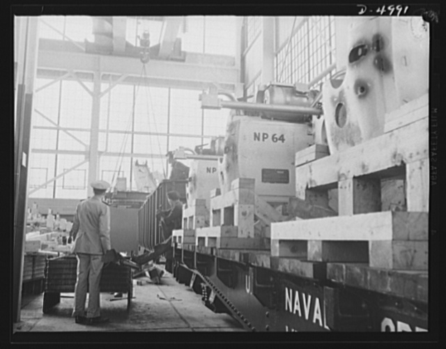 Production. Naval gun mounts. Big naval gun mounts produced in a Midwest factory shipped at a steadily increasing rate to undisclosed destinations. Westinghouse, Louisville, Kentucky