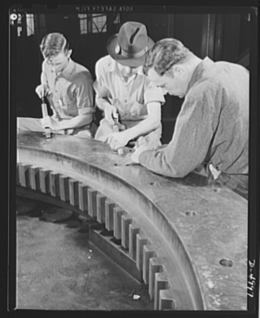 Production. Naval gun mounts. Final finishing of a large naval gun mount is well under way as workmen of a Midwest machine shop do a careful job of scraping surfaces. Westinghouse, Louisville