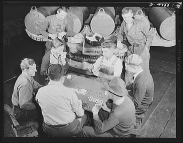 Production. Naval gun mounts. Periods of relaxation are short for the men who make big naval gun mounts in a Midwest facotry. A quick lunch, a few hands of cards, and they're back at the job of providing Uncle Sam the tools of war. Westinghouse, Louisville, Kentucky