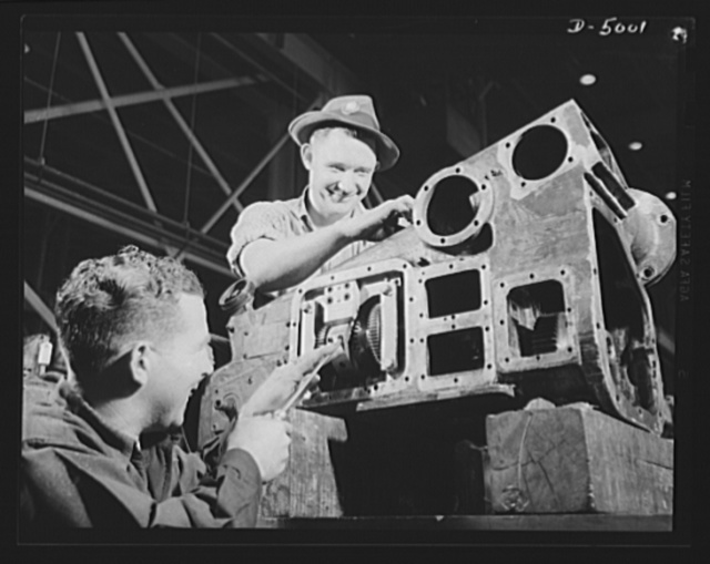 Production. Naval gun mounts. The gear drive of a naval gun mount is carefully assembled and fitted in a large Midwest plant, which is also producing torpedo tube mounts. Westinghouse, Louisville