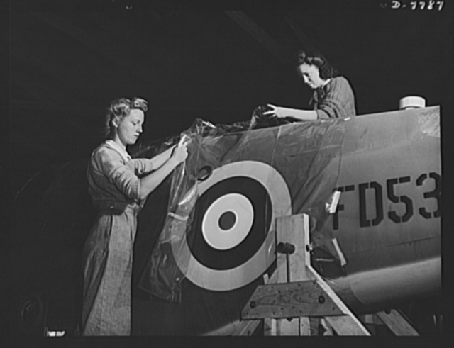 """Production. P-51 """"Mustang"""" fighter planes. A cellophane cover is applied to North American """"Mustang"""" fighters in the shipping department of Inglewood, California, plant, before they are crated and shipped to the  Royal Air Force (RAF). This plant produces the battle-tested B-25 """"Billy Mitchell"""" bomber, used in General Doolittle's raid on Tokyo, and the P-51 fighter plane which was first brought into prominence by the British raid on Dieppe"""