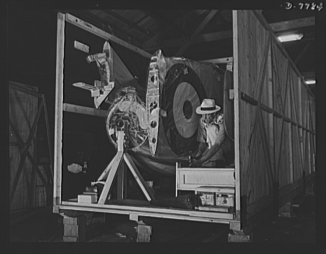 "Production. P-51 ""Mustang"" fighter planes. A North American ""Mustang"" fighter plane is placed in a crate for shipment from the plant at Inglewood, California, to the Royal Air Force (RAF). This plant produces the battle-tested B-25 ""Billy Mitchell"" bomber, used in General Doolittle's raid on Tokyo, and the P-51 fighter plane which was first brought into prominence by the British raid on Dieppe"