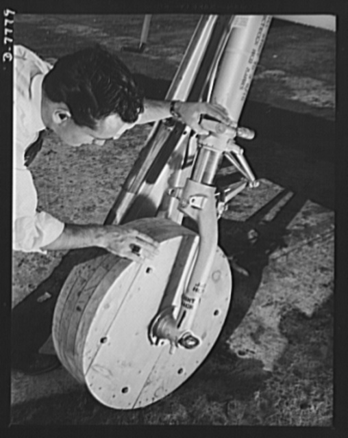 """Production. P-51 """"Mustang"""" fighter planes. An employee checks one of the temporary wooden wheels placed on a P-51 fighter on the North American flight training at the Inglewood, California, plant. Regular rubber tires are installed when the planes are ready for flight tests. This plant produces the battle-tested B-25 """"Billy Mitchell"""" bomber, used in General Doolittle's raid on Tokyo, and the P-51 fighter plane which was first brought into prominence by the British raid on Dieppe"""
