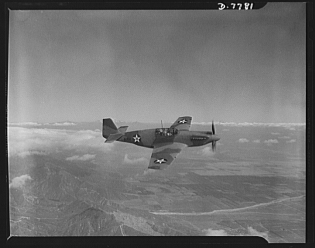 """Production. P-51 """"Mustang"""" fighter planes. One of the Army's new P-51 """"Mustang"""" fighters in flight near the North American Aviation plant at Inglewood, California. This plant produces the battle-tested B-25 battle-tested B-25 """"Billy Mitchell"""" bomber, used in General Doolittle's raid on Tokyo, and the P-51 fighter plane which was first brought into prominence by the British raid on Dieppe"""