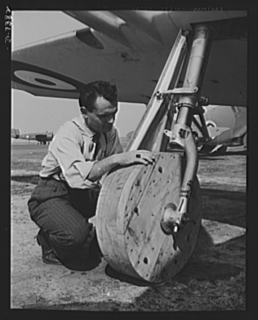 """Production. P-51 """"Mustang"""" fighter planes. Wooden wheels are attached to a P-51 """"Mustang"""" fighter plane, so it may be moved around the ramp at the Inglewood, California plant of North American Aviation, Incorportated. When it is ready for flight tests, regular landing wheels with rubber tires will be substituted. This plant produces the battle-tested B-25 """"Billy Mitchell"""" bomber, used in General Doolittle's raid on Tokyo, and the P-51 """"Mustang"""" fighter plane, which was first brought into prominence by the British raid on Dieppe"""