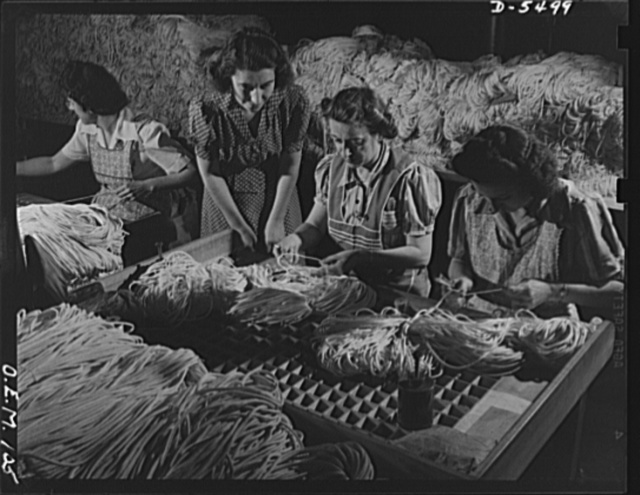 Production. Parachute cloth and shrouds. Inspecting parachute shroud lines before they are packed and shipped from an Eastern plant. All the inspectors are good Americans of foreign descent. They represent, Irish, French, Italian and Hungarian ancestry