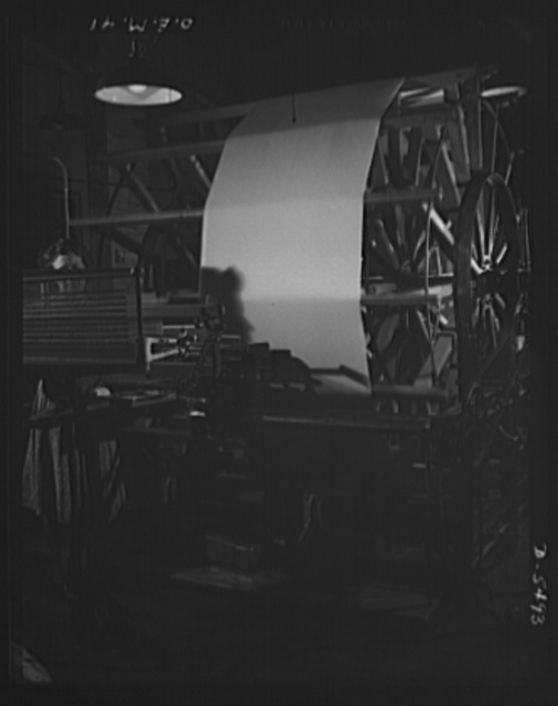 Production. Parachute cloth and shrouds. Warping operation in preparing silk for parachute cloth manufacture in an Eastern plant. Looking toward the reel on which the silk is wound in preparation for the weaving machine