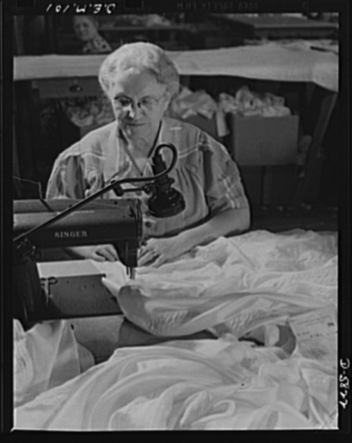 Production. Parachute making. Mother of a sergeant in the Army, wife of a World War I veteran, Mrs. Emilia Gworek is a soldier in her own right. Here she sews parachute seams during the night shift of an Eastern plant. In the daytime, she is active in Red Cross work and is president of her American Legion Auxiliary. Pioneer Parachute Company, Manchester, Connecticut