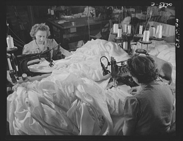 Production. Parachute making. Not gowns for a bal, but chutes for a fall are these yards and yards of silk, here being stitched together in an Eastern parachute manufacturing plant. Pioneer Parachute Company, Manchester, Connecticut
