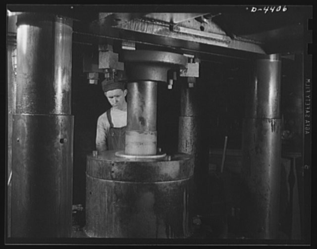Production. Pipe fittings. A giant press used in a Midwest plant now forging 75 mm shells for the Army. Tube Turn Incorporated