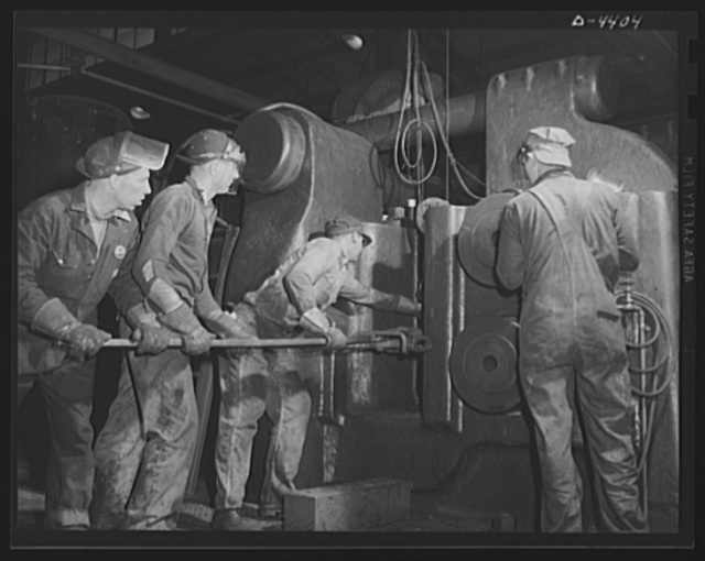 Production. Pipe fittings. Forging shop crew of a Midwest plant serve the world's largest machine of its kind a nine inch upsetter. This machine is used for forging 75 mm shells for the Army. Tube Turn Incorporated